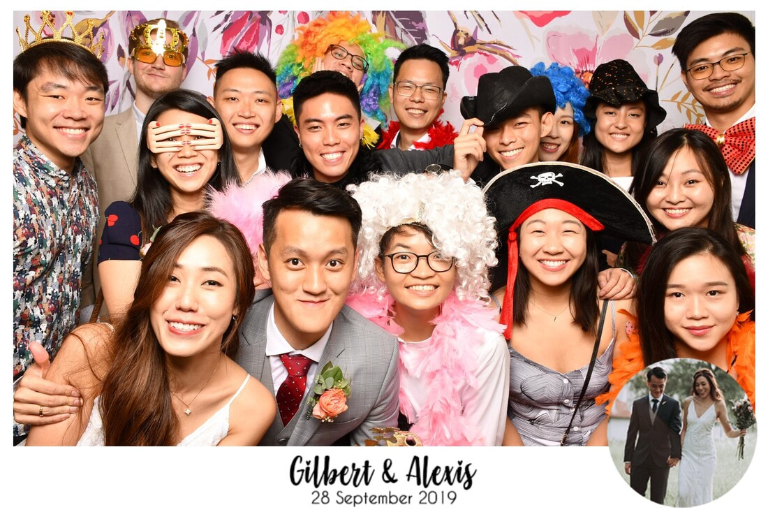 wedding photobooth singapore with floral backdrop design